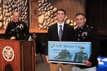 Brendan G. Walsh, a resident of Trumbull, Connecticut, and recent graduate of Brien McMahon High School, is one of this year's Naval Reserve Officer Training Corps Scholarship Program, Marine Corps Option, recipients. Maj. Thomas Abbott, left, and 1st Lt. Stefan Milan, right, present Walsh with a $180,000 scholarship during a high school awards ceremony June 3, 2015, at the school. (Official U.S. Marine Corps photo by Staff Sgt. Richard Blumenstein.)