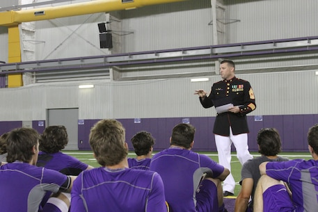 Master Sergeant Kevin Boggs, Recruiting Station Baton Rouge Officer Selection Assistant, gives a motivational speech to the players of the Louisiana State University baseball team, June 5. The team will be playing UL-Lafayette this weekend in the National Collegiate Athletic Association Super Regional at the Alex Box Stadium in Baton Rouge. The winner of the best-of-three Super Regional advances to the College World Series in Omaha, Nebraska, June 13-24.