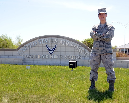 2nd Lt. Ashley Newberry, 10th Space Warning Squadron chief of operations training, stands at the front gate of Cavalier Air Force Station, N.D. June 4, 2015. Newberry was selected to be the Grand Forks Air Force Base, N.D. Warrior of the Week for the first week of June. (U.S. Air Force photo by Senior Airman Zachiah Roberson/released)