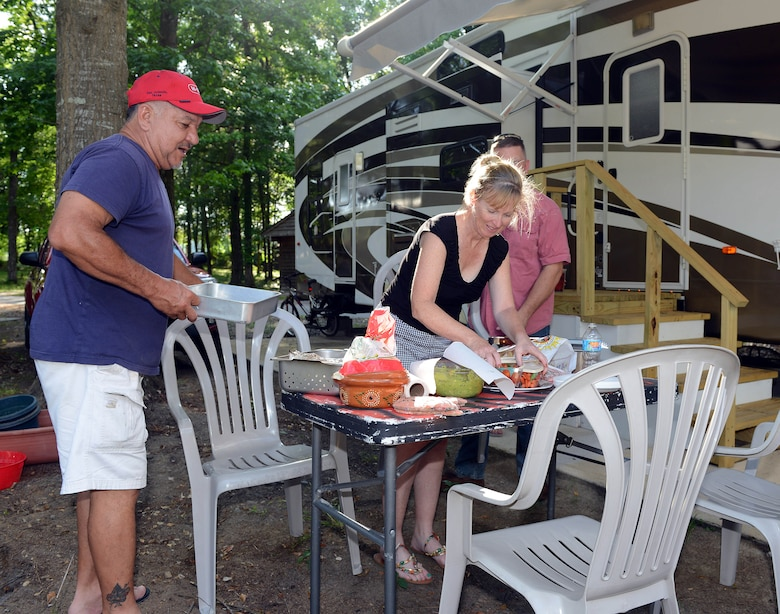Retiree Juan Bermudez and his wife, Kelli, prepare for an evening cookout at Robins Family Campground, May 20, 2015. (U.S. Air Force photo by Tommie Horton)