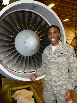 Senior Airman Jordan Traore, 175th Maintenance Squadron, stands in front of an engine for an A-10C Thunderbolt II. Traore is the June spotlight Airman in the Maryland Air National Guard. (U.S. Air National Guard photo by Tech. Sgt. David Speicher/RELEASED)