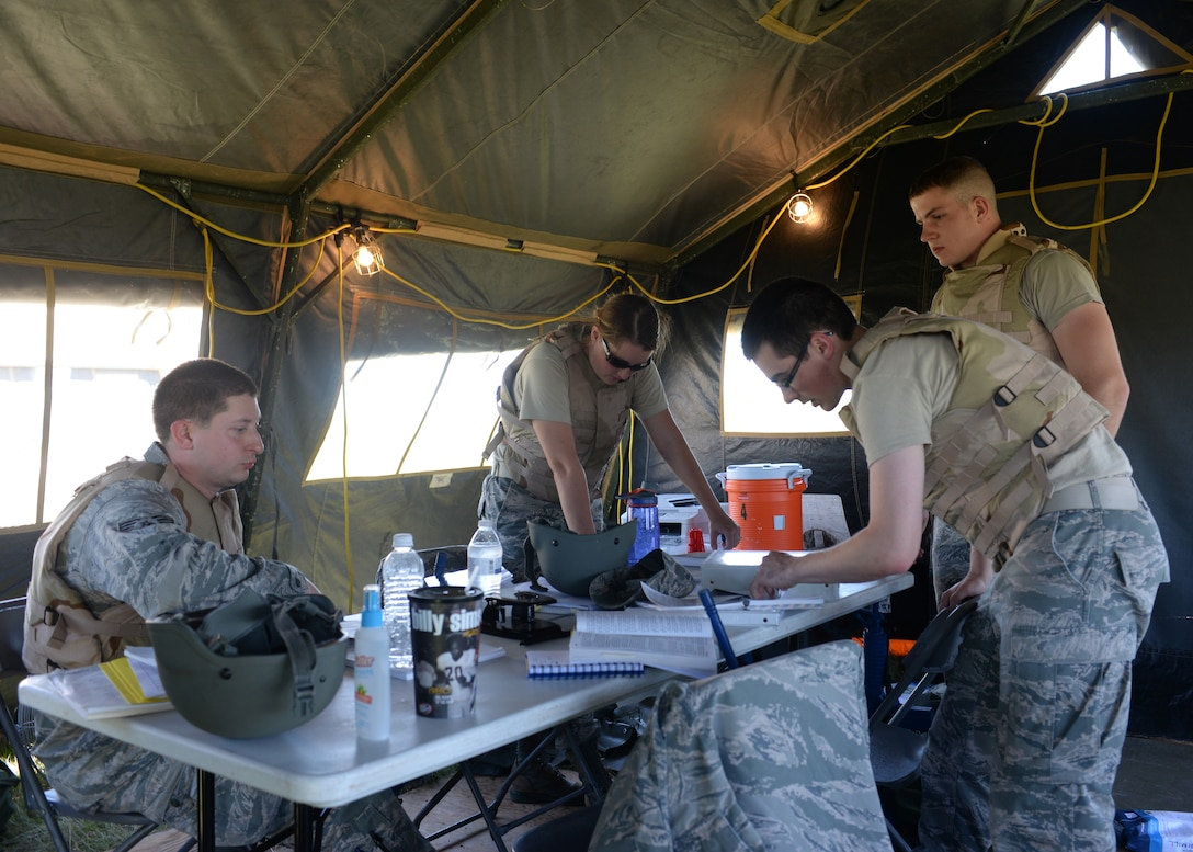 U.S. Air Force contract specialists from Altus Air Force Base and Sheppard Air Force Base, Texas prepare contracts for simulated vendors at Altus Air Force Base, Oklahoma, June 3, 2015. The Airmen completed simulated contracts to provide their base with water and other essentials. (U.S. Air Force photo by Airman 1st Class Kirby Turbak)