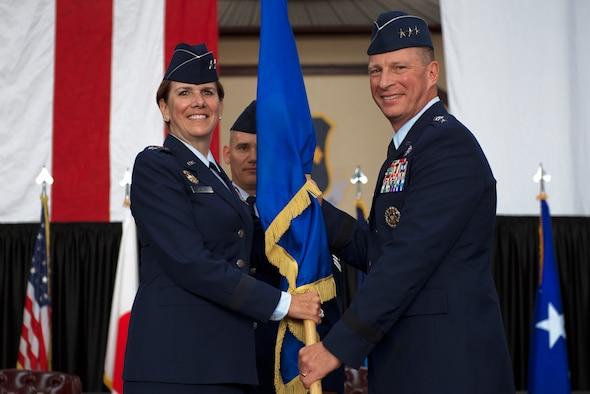 Gen. Lori J. Robinson, the Pacific Air Forces commander, passes the U.S. Forces Japan guidon to the new U.S. Forces Japan and 5th Air Force Commander Lt. Gen. John L. Dolan, during a change of command ceremony June 5, 2015, at Yokota Air Base, Japan. The passing of the guidon marks the beginning of Dolan's tour as the commander of the USFJ and 5th Air Force. (U.S. Air Force photo/Airman 1st Class Delano Scott)