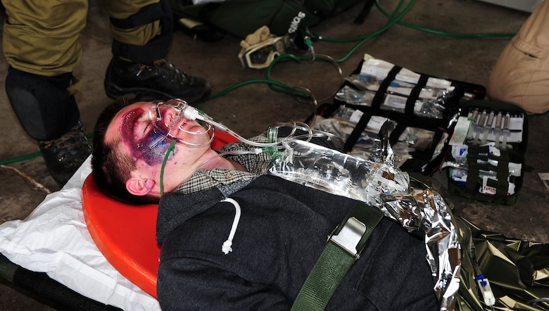Ryan Gould, Air Force Reserve Officer Training Corps cadet, is treated for a simulated traumatic brain injury during an Angel Thunder 2015 mass casualty exercise at  Winslow-Lindbergh Regional Airport, Ariz., June 5, 2015. The patients were transported from Camp Navajo Training Site to the casualty collection point where they were triaged for injuries ranging from trauma-induced child labor to scrapes. (U.S. Air Force photo by Airman 1st Class Chris Drzazgowski/Released)