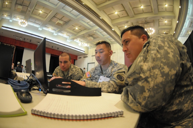 Hawaii Army National Guard soldiers discuss cyber defensive strategies during the Po'oihe 2015 Cyber Security Exercise at the University of Hawaii Manoa Campus Center Ballroom on June 4, 2015. Po'oihe is part of the hurricane preparedness Exercise Vigilant Guard / Makani Pahili 2015 hosted by U.S. Northern Command, National Guard Bureau and the Hawaii Emergency Management Agency. (U.S. Air National Guard photo by Airman 1st Class Robert Cabuco)