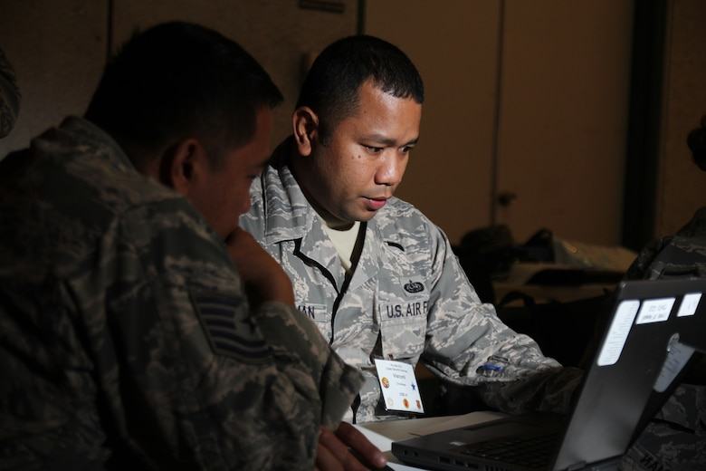 Staff Sgt. Visconti Christman, of the 109 Air Operations Group, Hawaii Air National Guard, defend against cyber attacks during the Po'oihe 2015 Cyber Security Exercise at the University of Hawaii Manoa Campus Center Ballroom on June 4, 2015. This year's exercise scenario will test the ability of participants to react to a Statewide natural disaster that create opportunities for malicious cyber attacks. (U.S. Air National Guard photo by Airman 1st Class Robert Cabuco)