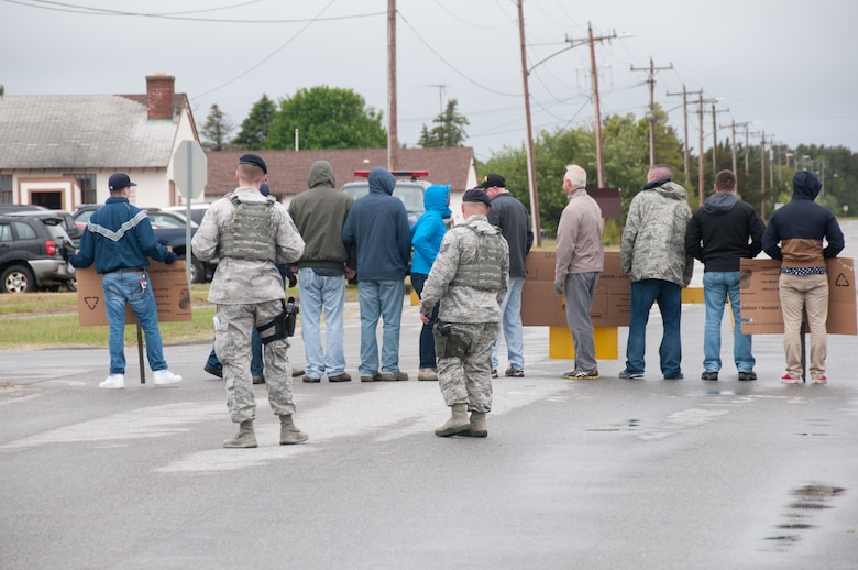 Members of the 102nd Security Forces Squadron mitigate a simulated protest during the June Annual Training exercise. The 102nd Intelligence Wing participated in a large-scale multi-scenario training exercise June 2 - 4. The exercise helped improve the wing's preparedness as incident responders in the Cape Cod area. (Air National Guard photo by Staff Sgt. Nikoletta Kanakis)