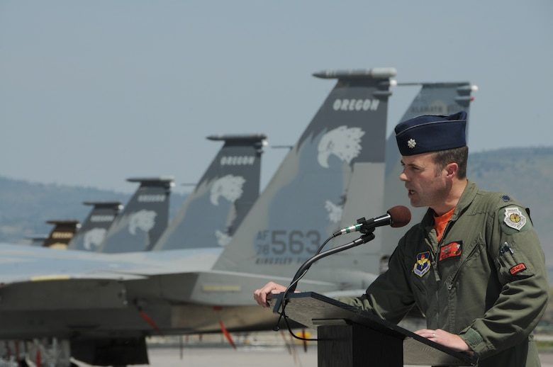 U.S. Air Force Lt. Col. Jeffrey Edwards takes command of the 173rd Operation Group after a unique change of command ceremony at Kingsley Field, Ore. May 1, 2015. Edwards and French conducted an aerial change of command ceremony in which Edward's F-15 pulled ahead of Col. Frederick French's aircraft as a symbol of taking the lead of the group. (U.S. Air National Guard photo by Senior Airman Penny Snoozy)