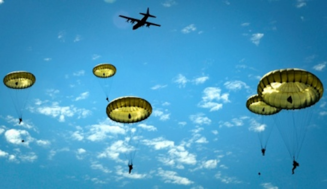 Paratroopers jump onto the Iron Mike drop zone here, June 8, 2014. More than 600 U.S., German, Dutch and French service members jumped to honor the paratroopers that jumped into Normandy on D-Day. The event was one of several commemorations of the 70th Anniversary of D-Day operations conducted by Allied forces during World War II June 5-6, 1944. Over 650 U.S. military personnel have joined troops from several NATO nations to participate in ceremonies to honor the events at the invitation of the French government.  (U.S. Air Force photo/Staff Sgt. Sara Keller)