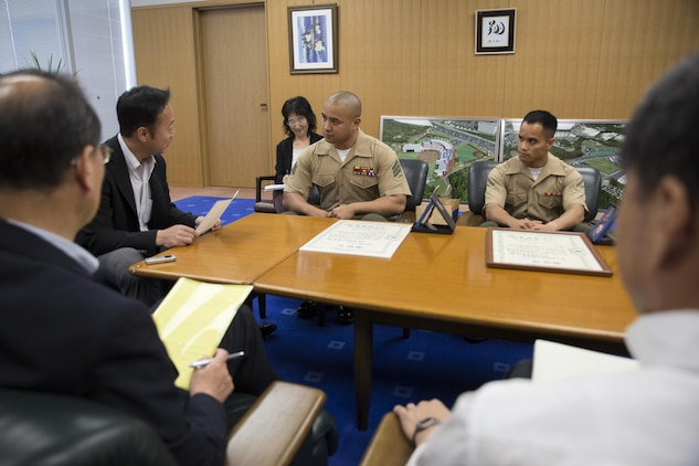 Yoshihiko Fukuda, mayor of Iwakuni City, converses with representatives from Headquarters and Headquarters Squadron and Marine Aerial Transport Refueler Squadron 152 aboard Marine Corps Air Station Iwakuni, Japan, during their meeting at city hall June 3, 2015. The representatives went to city hall to report to the mayor after receiving awards from the Japan Good Deeds Association during their 65th Spring Commendation Ceremony in May. H&HS and VMGR-152 received the awards for assisting the local community whose homes were affected by a mudslide in August 2014.