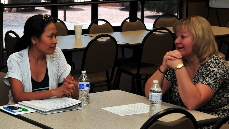 Arizona Air National Guard spouses discuss issues facing military families during a key spouse program meeting at the 161st Air Refueling Wing, Phoenix, June 7. The key spouse program is an official family program designed to enhance readiness, establish a sense of unity within the Air Force community and to address the needs of military families. (U.S. Air National Guard photo by Tech. Sgt. Michael Matkin)