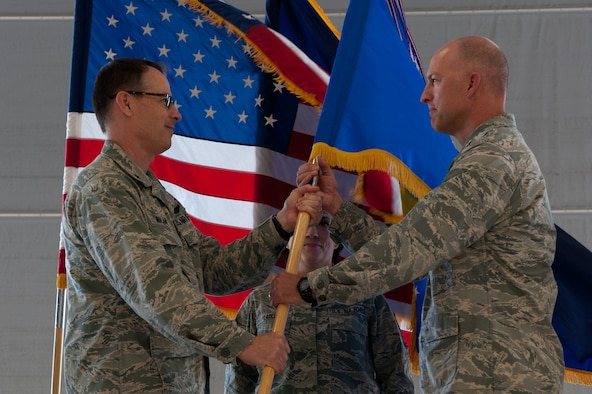 Col. Timothy J. Donnellan assumes command of the 124th Fighter Wing during a change of command ceremony June 7, 2015 at Gowen Field, Boise, Idaho. (Air National Guard photo by Tech. Sgt. Joshua C. Allmaras)