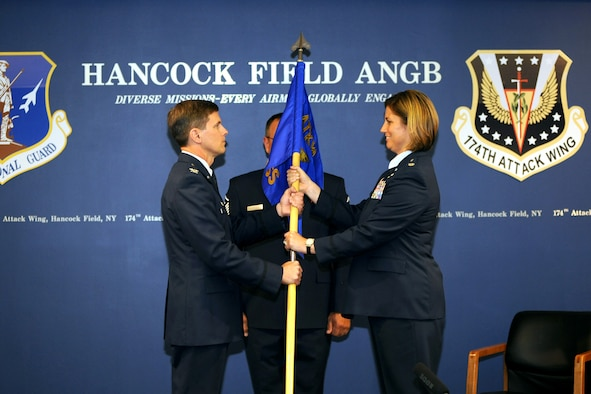 New York Air National Guard Lt. Col. Michele L. Kilgore receives the Operation Group flag from Col. Greg Semmel, 174th Attack wing commander, at Hancock Field in Syracuse, N.Y. 7 June 2015.  Kilgore was presented with the ceremonial flag at the Assumption of Command ceremony where she officially took over as the Commander of the 174th Operations Group.  (New York Air National Guard Photo by Tech. Sgt. Jeremy M. Call/Released)