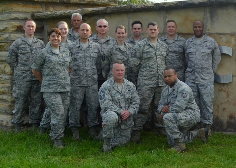 Members of the Missouri Air National Guard's 131st Bomb Wing who served as support staff during the 131st's state emergency response training at Camp Clark, near Nevada, Missouri, June 6, 2015. Standing from left to right are Tech. Sgt. Pete Young, Master Sgt. Kirsten Inwood, Tech. Sgt. Stephanie Mundwiller, Senior Master Sgt. Kirk Lindell, Master Sgt. James Bradley, Senior Master Sgt. John Chaffee, Master Sgt. Jen Fanoele, Tech. Sgt. Joe Hudson, Master Sgt. Joshua Adkins, Master Sgt. Ronnie Bylo, Capt. Aaron Armstrong, and kneeling are Senior Master Sgt. Ken Huff and Tech. Sgt. Jarrad Luckey.