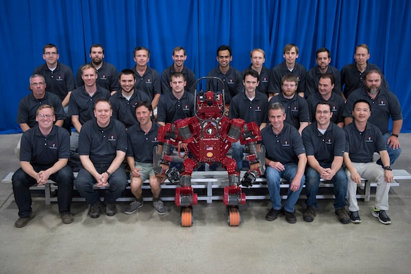 A group photo of Team Tartan Rescue and its robot CHIMP, which stands for CMU highly intelligent mobile platform. Team Tartan Rescue won third prize at the DARPA Robotics Challenge Finals held June 5-6, 2015, in Pomona, Calif. DARPA photo