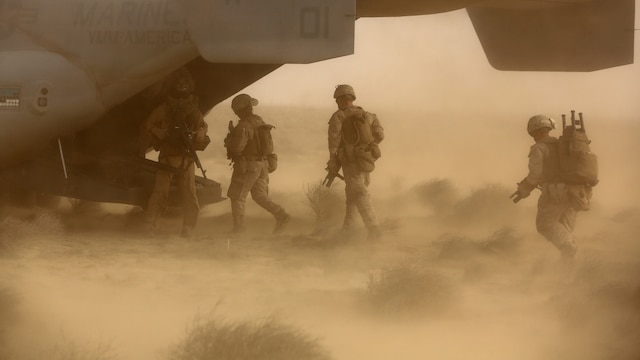 Marines and Sailors with India Company, 3rd Battalion, 7th Marine Regiment, Special Purpose Marine Air Ground Task Force – Crisis Response – Central Command, escort a simulated isolated person onto an MV-22 Osprey during a tactical recovery of aircraft and personnel training exercise, May 29, 2015, in Southwest Asia. With U.S. and coalition forces conducting airstrikes in support of Operation Inherent Resolve, the TRAP forces of the SPMAGTF provide an on-call force dedicated to the safe return of the U.S. and coalition service members.