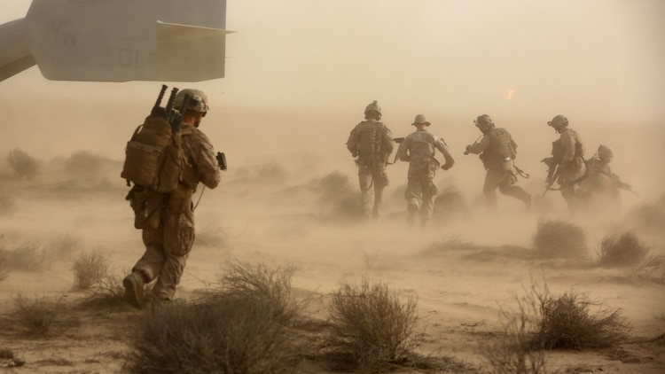 Marines and Sailors with India Company, 3rd Battalion, 7th Marine Regiment, Special Purpose Marine Air Ground Task Force – Crisis Response – Central Command, escort a simulated casualty to an MV-22 Osprey during a tactical recovery of aircraft and personnel training exercise, May 29, 2015, in Southwest Asia. With U.S. and coalition forces conducting airstrikes in support of Operation Inherent Resolve, the TRAP forces of the SPMAGTF provide an on-call force dedicated to the safe return of the U.S. and coalition service members. (U.S. Marine Corps Photo by Cpl. Garrett D. White, CJTF-OIR Public Affairs)