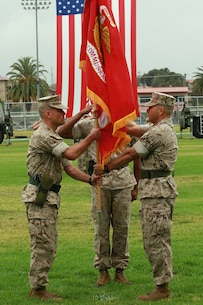 Lieutenant Col. Damon K. Burrows, left, the newly-appointed commanding officer of 9th Communication Battalion, I Marine Expeditionary Force Headquarters Group, receives the battalion colors from Lt. Col. Matthew R. Simmons, outgoing commanding officer, during a change of command ceremony aboard Marine Corps Base Camp Pendleton, Calif., June 4, 2015. Burrows most recently served as the assistant chief of staff, G-6, for the 1st Marine Logistics Group, I MEF, and said he plans to increase the battalion's cyber operations presence and effectiveness. (U.S. Marine Corps photo by Lance Cpl. Caitlin Bevel)