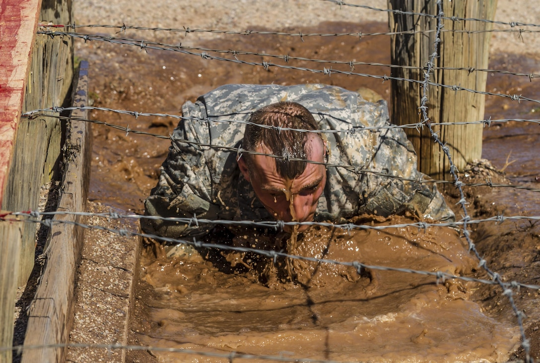 Army Reserve drill sergeant, Staff Sgt. Russell Vidler, 98th Training Division (IET), negotiates the mud obstacle during the third day of competition at the 108th Training Command (IET) combined Best Warrior and Drill Sergeant of the Year competition held at Fort Huachuca, Ariz. Vidler is one of five drill sergeants competing for the top honor in this year's competition. (U.S. Army photo by Sgt. 1st Class Brian Hamilton)