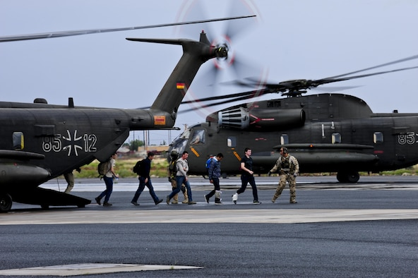 German air force rescue personnel lead simulated patients off of a German army CH-53GS during an Angel Thunder 2015 mass casualty exercise at Winslow-Lindbergh Regional Airport, Ariz., June 5, 2015. U.S. military forces and partner nations worked together during the exercise to transport patients from Camp Navajo Training Site, Ariz., to the casualty collection point located at the Winslow–Lindbergh Regional Airport. (U.S. Air Force photo/Airman 1st Class Chris Drzazgowski)