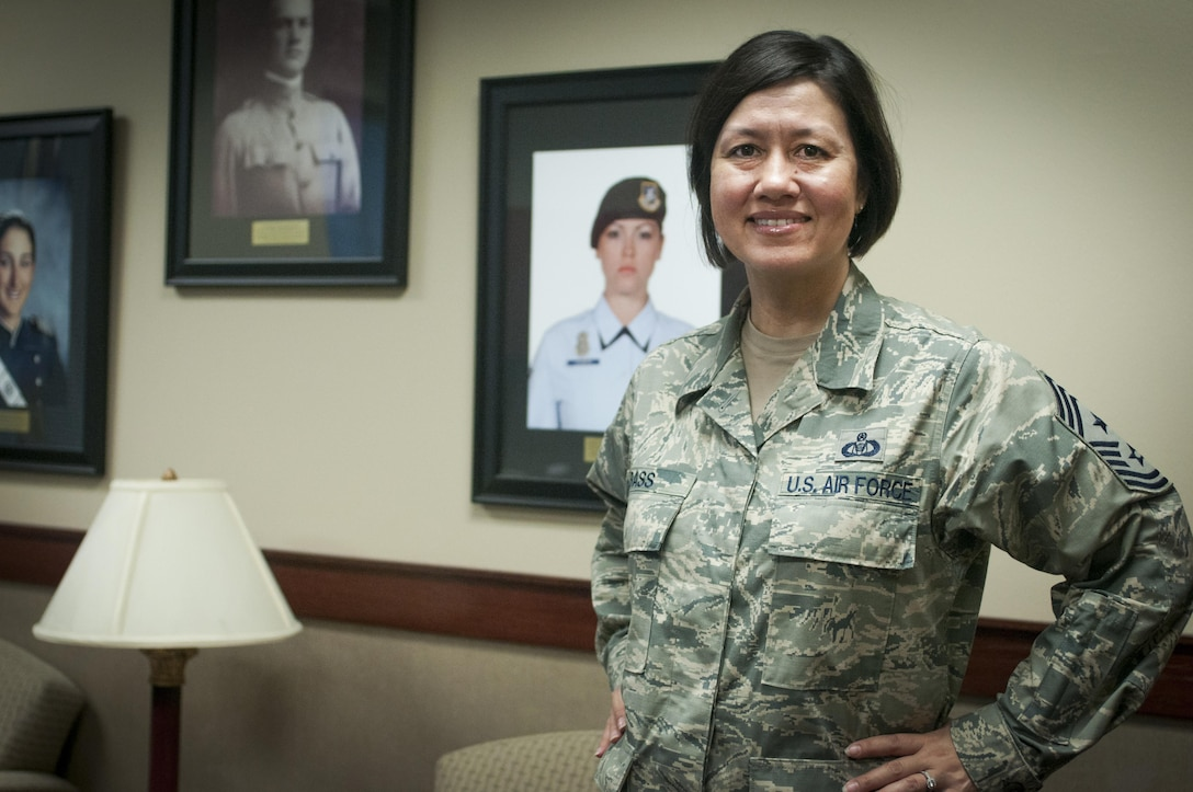 U.S. Air Force Chief Master Sgt. JoAnne S. Bass, 17th Training Wing Command Chief, poses for a photo in the Norma Brown Building on Goodfellow Air Force Base, Texas, June 6, 2015. Bass is Goodfellow's 24th command chief. (U.S. Air Force photo by Staff Sgt. Michael Smith/Released)