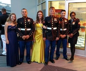 29 May 2015 – (L to R) Bianka Villasenor, PFC Klinedinst, Ashley Poley, LCpl Vandegrift, PFC Freudiger, and Cpl Kronberger pose for a group photo on the observation deck at the USS North Carolina during the Weapons Training Battalion Dining In.