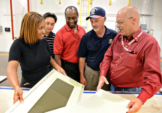 Sharmeitra Threatt, Harris Chandra, Keith Gray and Danny Thompson, members of the 424th Supply Chain Management Squadron, talk about the KC-135 Stratotanker balance panel overhaul process with Dan Mitchell from the 551st Commodities Maintenance Squadron at Tinker Air Force Base, Okla. The base can now make and overhaul these panels instead of ordering new ones. (Air Force photo/Kelly White)