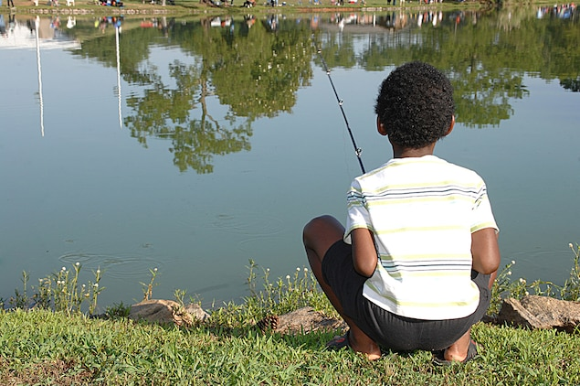 A young angler patiently watches his bobber, hoping for the big one, during Marine Corps Logistics Base Albany's 27th annual Buddy Fishing Tournament at Covella Pond here, June 6.