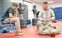 Sgt. Joshua Guertin, right, of Company B, 1st Attack Reconnaissance Battalion, 1st Combat Aviation Brigade, 1st Infantry Division, demonstrates a dominant position in Modern Army Combatives.