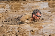 More than 6,000 racers participated in the opening day of the 2015 World Famous Mud Run here, June 6. The Mud Run, open to authorized military and civilian participants, includes a 10k and a 5k option with hills, tire obstacles, river crossings, two 5-foot walls with mud on both sides, a tunnel crawl, a cargo net climb and a final 30-foot long mud pit. The series will also have a 1k kids' Mud Run for children ages 4 to 12.