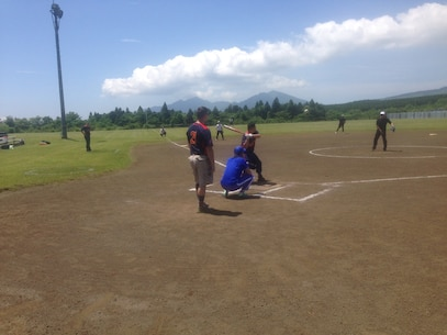 Sgt Lyons looks to crush the ball during the 1st Annual Camp Fuji - JGSDF - Fuji Friendship Association Sports Tournament.