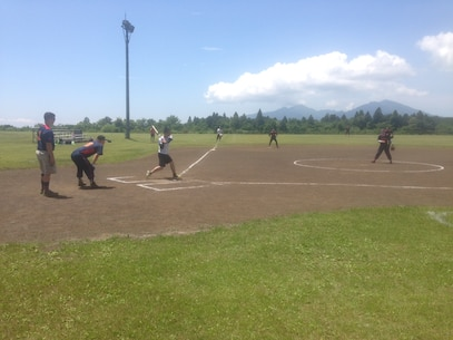 Cpl Curtis winds up to deliver a pitch during the 1st Annual Camp Fuji - JGSDF - Fuji Friendship Association Sports Tournament.