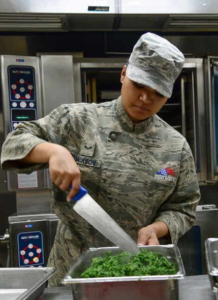 Airman 1st Class Linsun Jackson, 51st Force Support Squadron food service specialist, prepares spinach for lunch April 1, 2015, at Osan Air Base, Republic of Korea. The dining facilities serve not only the 51st Fighter Wing, but also the 7th Air Force, numerous tenant units and deployed personnel. (U.S. Air Force photo by Senior Airman Matthew Lancaster)