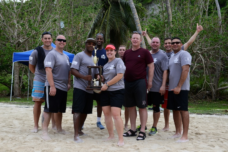 Team Andersen first sergeants stand together after winning a beach volleyball tournament against the First Four and commanders June 5, 2015, at Tarague Beach on Andersen Air Force Base, Guam. The first sergeants beat the First Four Airmen in a best-of-three volleyball tournament and secured possession of the trophy until the next tournament.  (U.S. Air Force photo by Airman 1st Class Arielle Vasquez/Released)