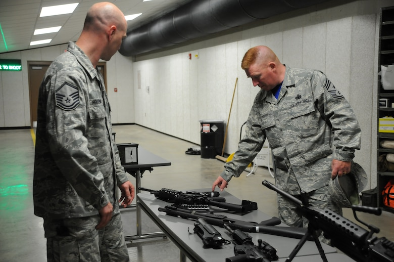 Chief Master Sgt. Michael Thorpe, 22nd Air Force Command Chief receives a weapons brief from Master Sgt. Stephen Houseman, noncommissioned officer in charge, 914 Security Forces Squadron Combat Arms Training and Maintenance, at Niagara Falls Air Reserve Station on June 6, 2015. Thorpe toured the installation with Maj. Gen. Stayce Harris 22nd Air Force Commander and visited with Airmen across the Wing. (U.S. Air Force photo by Tech. Sgt. Stephanie Sawyer)