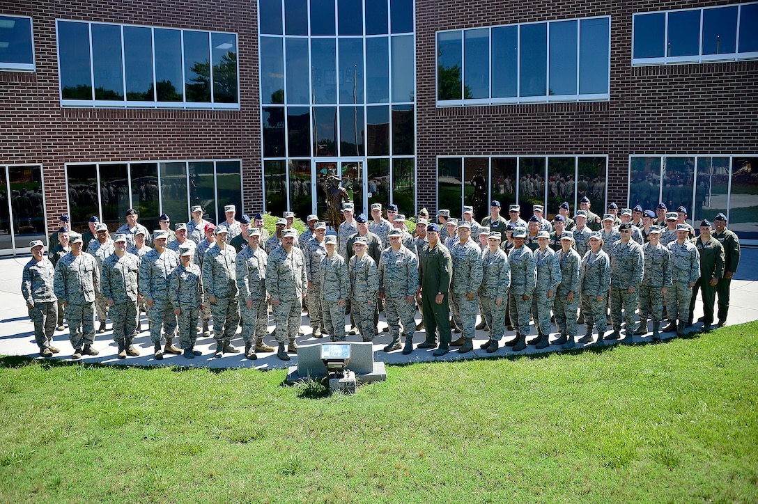 MCGHEE TYSON AIR NATIONAL GUARD BASE, Tenn. - More than 60 lieutenant colonels studying with the Air War College seminar at the I.G. Brown Training and Education Center here, June 4, 2015, form up outside Patriot Hall for their group photos. The officers were part of the AWC's fourth seminar on campus for the Air National Guard and Air Force Reserve Command, which included one Marine Corps officer in attendance. (U.S. Air National Guard photo by Master Sgt. Mike R. Smith/Released)