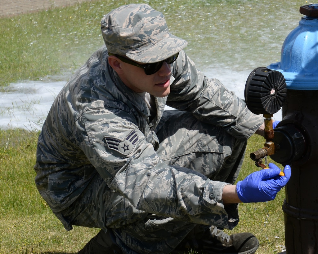 U.S. Air Force Senior Airman Joshua Slater, 100th Civil Engineer Squadron water and fuels system maintenance journeyman from Springfield, Mo., records the water pressure flowing through an open hydrant June 3, 2015, on RAF Mildenhall, England. There are no parameters on the residual water pressure; however, if the residual pressure is more than several pounds per square inch below the static pressure, it necessitates the need to investigate the situation as a foreign object may be constricting the flow of water. (U.S. Air Force photo by Gina Randall/Released)