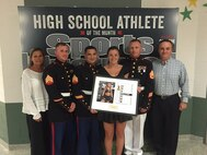 Marines with Marine Corps Recruiting Station New Jersey present Madison Schulte, senior at Seneca High School, with the Sports Illustrated High School Athlete of the Month for the month of May at the sports award ceremony, June 2, 2015. Schulte was chosen for the award for demonstrating leadership on the field, in the classroom, and in the community.