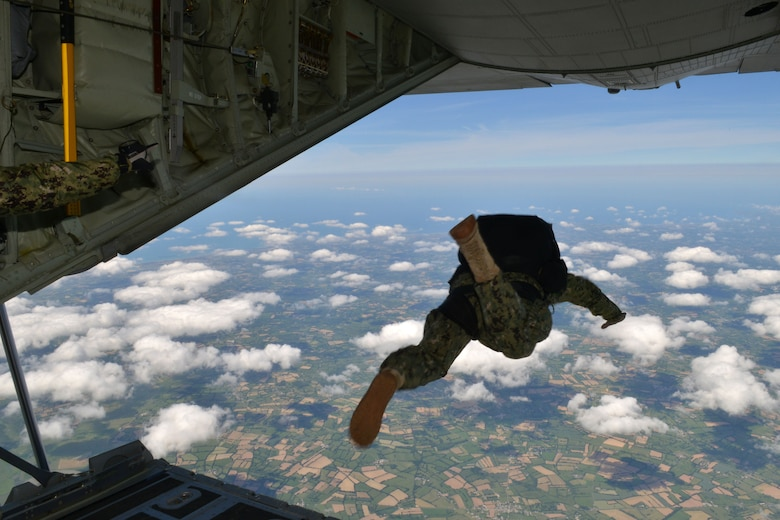 U.S. Special Operations Command -- Europe operator jumps off the ramp of an MC-130J Commando II assigned to the 67th Special Operations Squadron at RAF Mildenhall, England, to perform military free fall to the historic La Fiere drop zone near Sainte Mere Eglise, Normandy, France, June 7, 2015, to commemorate the 71st anniversary of D-Day. More than 60 SOCEUR operators performed the MFF jumps which were a small portion of the commemorative events which took place in strategic World War II sites throughout Normandy. (U.S. Air Force photo by Tech. Sgt. Stacia Zachary)
