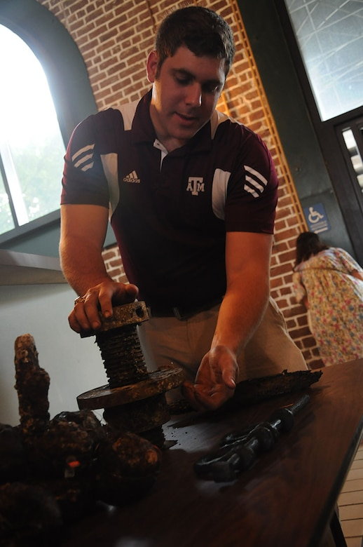 Parker Brooks, a conservator and graduate student from Texas A&M University's Conservation Research Laboratory, demonstrates the function of an elevator screw prior to a free lecture on the CSS Georgia at the Savannah History Museum, June 2.