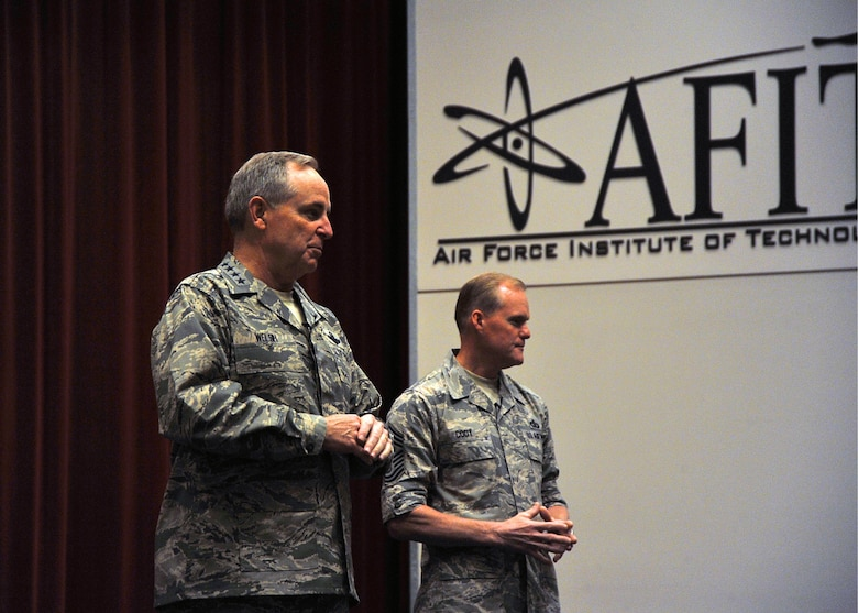 Air Force Chief of Staff Gen. Mark A. Welsh III accompanied by Chief Master Sgt. of the Air Force James A. Cody addressed an assembly of personnel during an all call held at the Air Force Institute of Technology on Wright Patterson Air Force Base, Ohio, June 8, 2015. (U.S. Air Force photo/Mike Libecap)