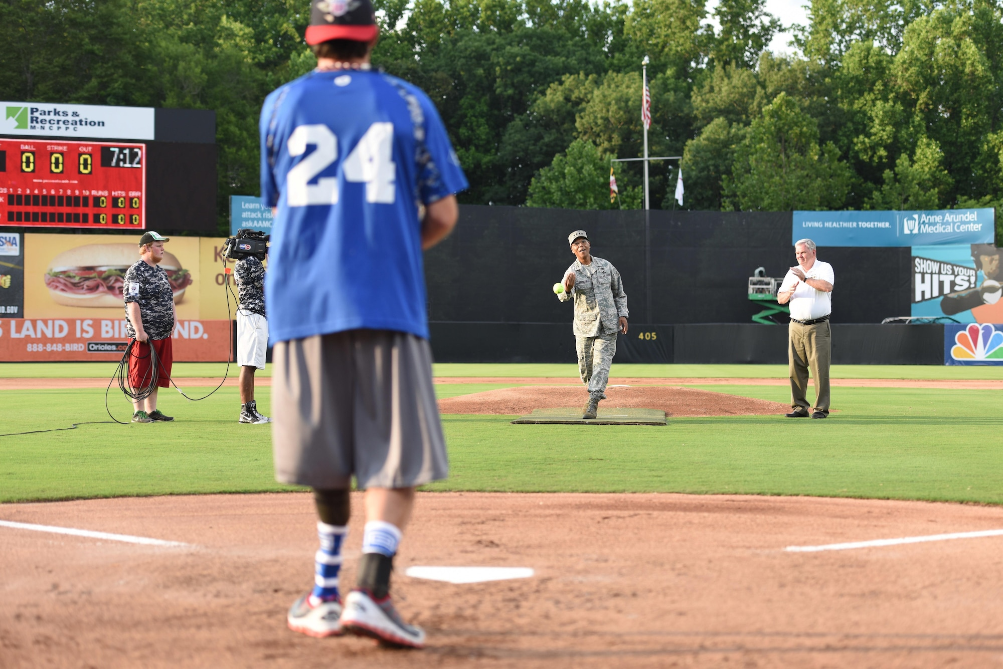 Air Force Vice Chief of Staff Gen. Larry O. Spencer throws the first pitch of the 3rd annual Amputee Warrior Softball Classic June 6, 2015, at Prince George's Stadium in Bowie, Md. (U.S. Air Force photos/Staff Sgt. Carlin Leslie)