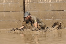 More than 6,000 racers participated in the opening day of the 2015 World Famous Mud Run here, June 6. The Mud Run, open to authorized military and civilian participants, includes a 10k and a 5k option with hills, tire obstacles, river crossings, two 5-foot walls with mud on both sides, a tunnel crawl, a cargo net climb and a final 30-foot long mud pit. The series will also have a 1k kids' Mud Run for children ages 4 to 12. (Photo by Lance Cpl. Asia Sorenson)