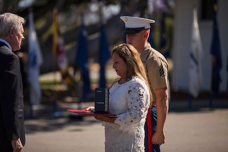 Secretary of the Navy Ray Mabus presents the Navy Cross to Rosa Peralta, the mother of the late Sgt. Rafael Peralta, during ceremony held in his honor aboard Camp Pendleton, Calif., June 8, 2015. Peralta was awarded the Navy Cross for his actions in support of Operation Al Fajr in Fallujah, Al Anbar province, Iraq, on Nov. 15, 2004, where he covered an enemy grenade with his body protect his fellow Marines. (U.S. Marine Corps photo by Lance Cpl. Clarence A. Leake/Released)