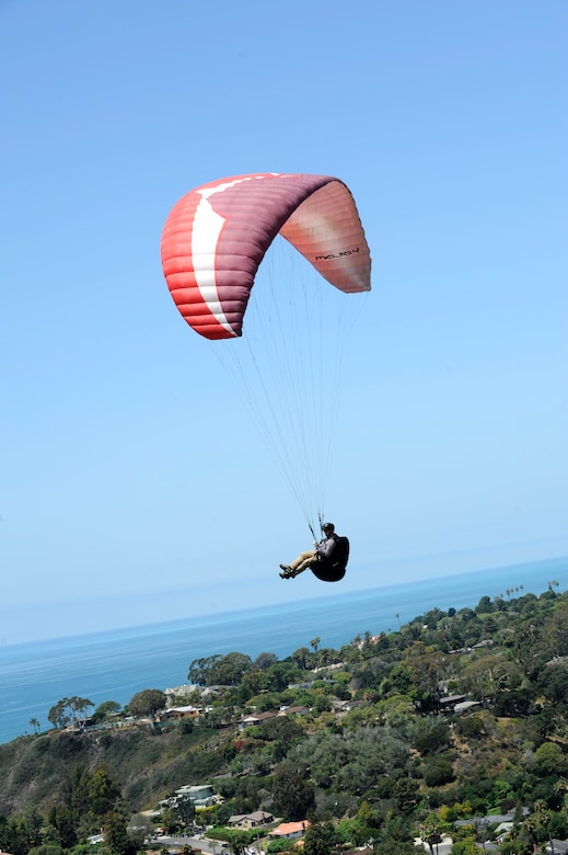 A paraglider enjoys his view during a flight, June 6, 2015, Santa Barbara, Calif. Vandenberg's Outdoor Recreation features the Single Airman Initiative, a program that enables Airmen to participate in diverse and adventurous events year-round. (U.S. Air Force Photo by Airman 1st Class Robert J. Volio/Released)