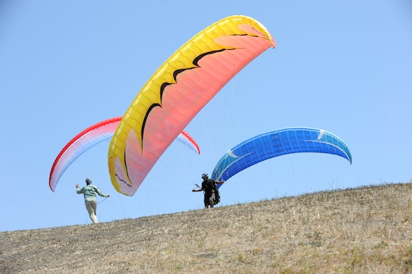 Staff Sgt. Kevin Brown, Joint Functional Component Command for Space intel analyst, follows instructions from Kevin Howe, paragliding instructor, June 6, 2015, Santa Barbara, Calif. Vandenberg's Outdoor Recreation features the Single Airman Initiative, a program that enables Airmen to participate in diverse and adventurous activities year-round. (U.S. Air Force Photo by Airman 1st Class Robert J. Volio/Released)
