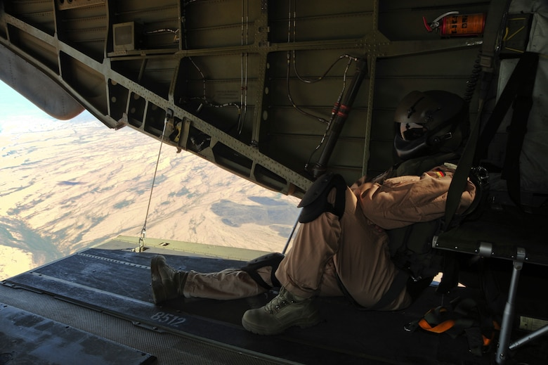 A German Air Force aerial gunner sits on the ramp of a German Air Force CH-53GS helicopter while flying over southern Arizona during Angel Thunder 2015 June 7, 2015.  Angel Thunder is the world's largest personnel recovery exercise.  D-M hosted 11 partner nations and nine interagencies with a common goal to train personnel recovery forces to prepare, plan, execute and adapt for rescue missions.   (U.S. Air Force photo by Airman 1st Class Chris Massey/Released)