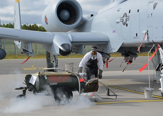 A crew chief assigned to the 175th Aircraft Maintenance Squadron, Maryland Air National Guard, services an A-10C Thunderbolt II aircraft with liquid oxygen during Saber Strike 15, Ämari Air Base, Estonia, June 8, 2015. Saber Strike is an exercise that aims to continue to improve U.S. interoperability with ally and partner nations, while increasing their capacity to conduct a full spectrum of military operations.  (Air National Guard photo by Tech. Sgt. Christopher Schepers)