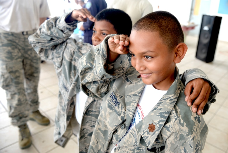 Children attending the Guardian of the Fatherland event at Puerto Castillo Naval Base in Trujillo, Honduras, June 6, 2015, try on the U.S. Air Force uniforms. More than 20 NEW HORIZONS Honduras 2015 personnel volunteered to participate in the event. NEW HORIZONS was launched in the 1980s and is an annual joint humanitarian assistance exercise that U.S. Southern Command conducts with a partner nation in Central America, South America or the Caribbean. The exercise improves joint training readiness of U.S. and partner nation civil engineers, medical professionals and support personnel through humanitarian assistance activities. (U.S. Air Force photo by Capt. David J. Murphy/Released)