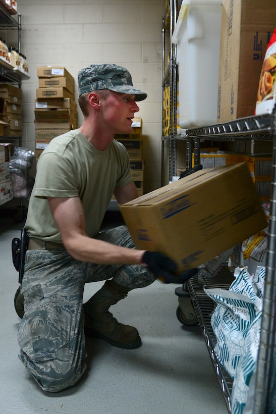 Airman 1st Class Jonathan Pippe, 51st Force Support Squadron food service specialist, stocks Ginko Tree food items onto shelves in the store room April 1, 2015, at Osan Air Base, Republic of Korea. Working the store room means being responsible for thousands of dollars' worth of food every month that must be stored, inventoried and accounted for with every delivery. (U.S. Air Force photo by Senior Airman Matthew Lancaster)